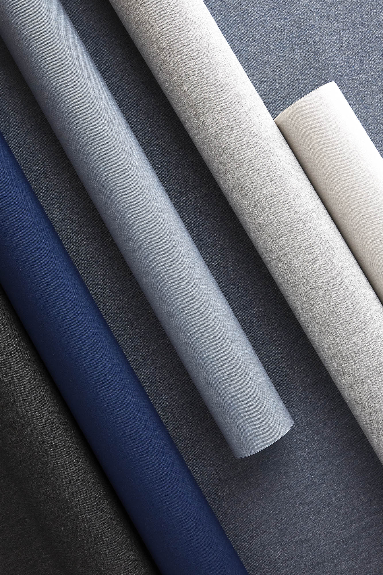 Sunbrella shade fabrics featuring the new solids of Cloud, Midnight and Slate Blue