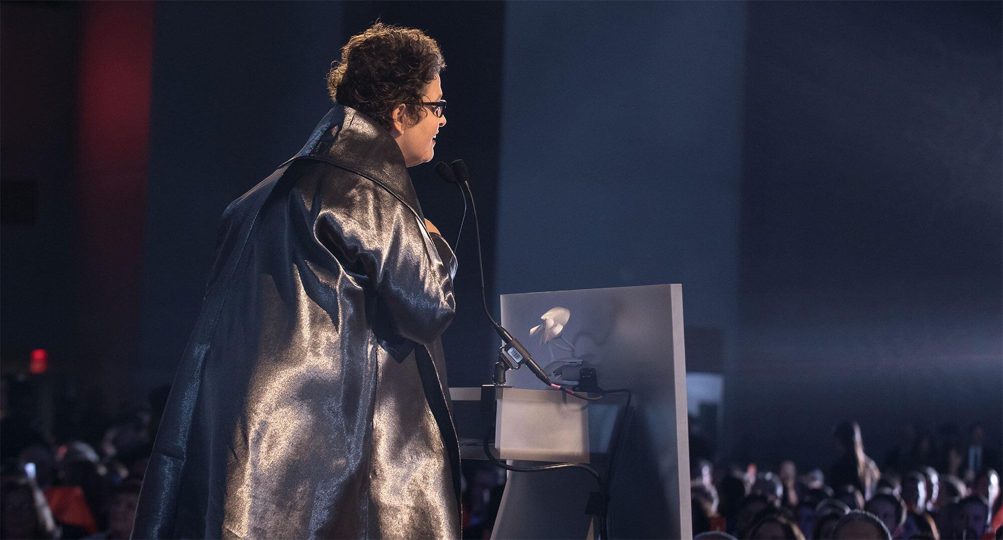 Over the shoulder shot of Cindy Allen speaking at the podium at Interior Design's Hall of Fame.