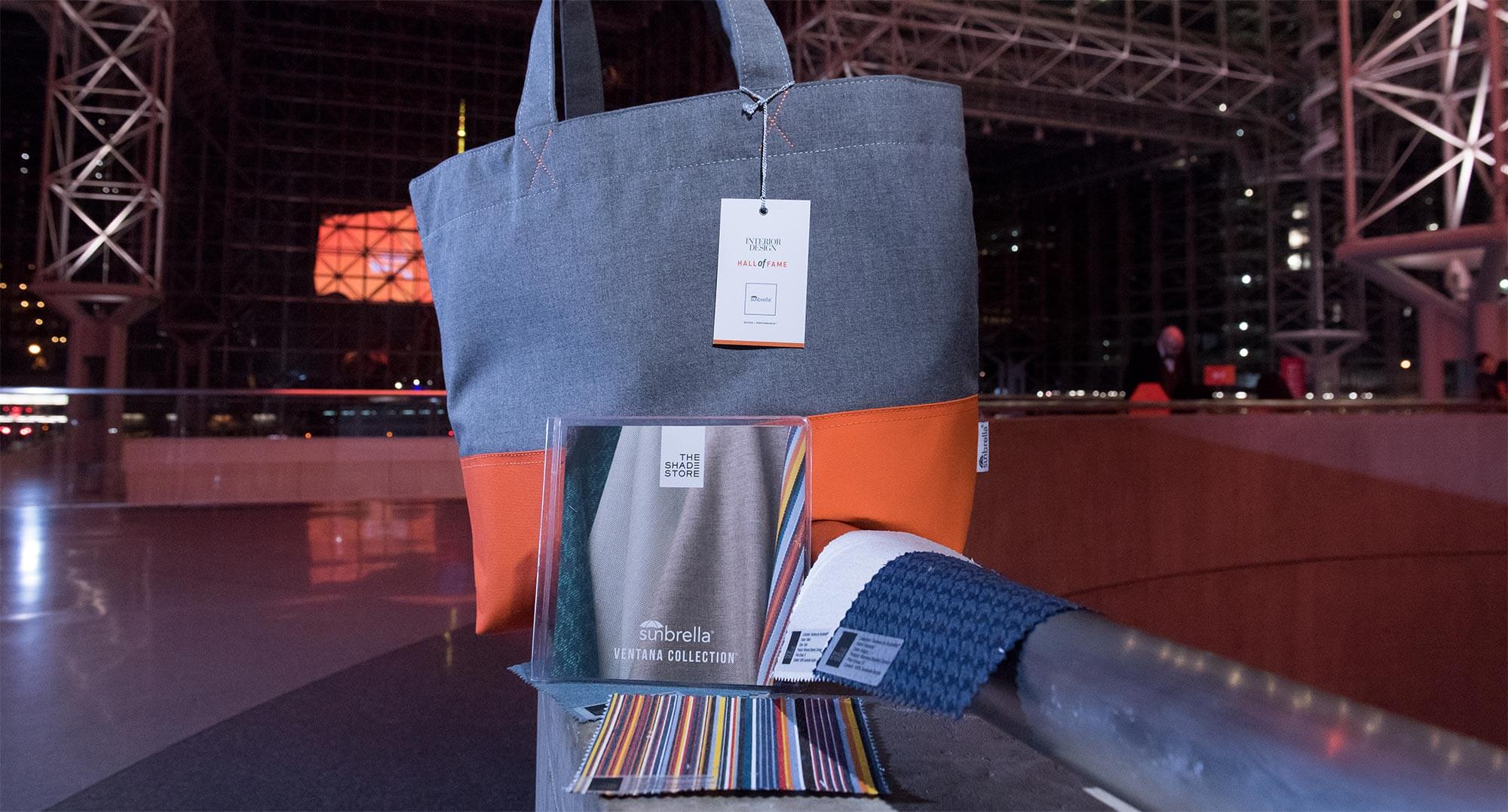 Close up of a tote gift bag made of Sunbrella performance fabric and Sunbrella giveaways.