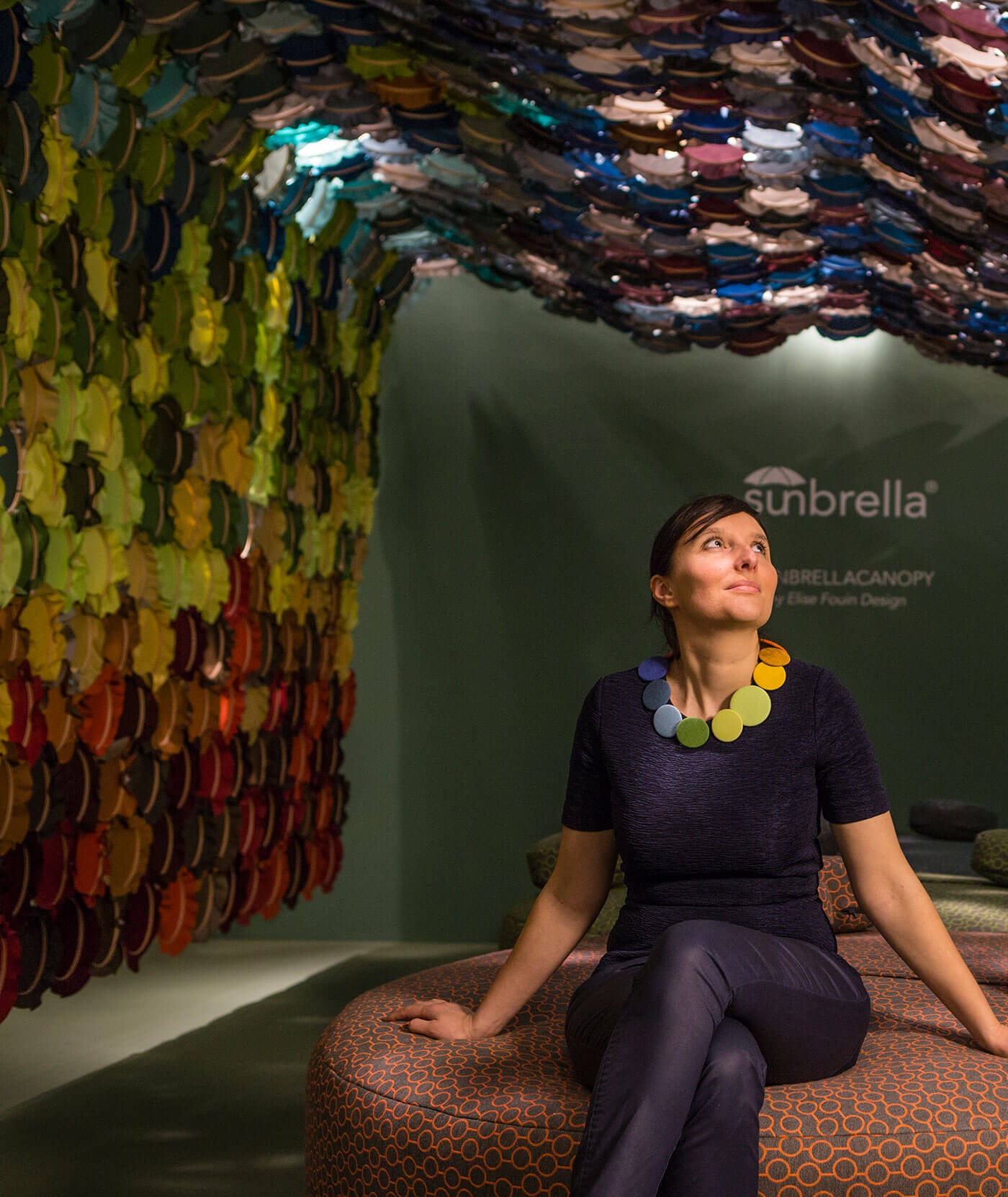 Art installation featuring bright colors of Sunbrella fabrics in interlocking embroidery hoops