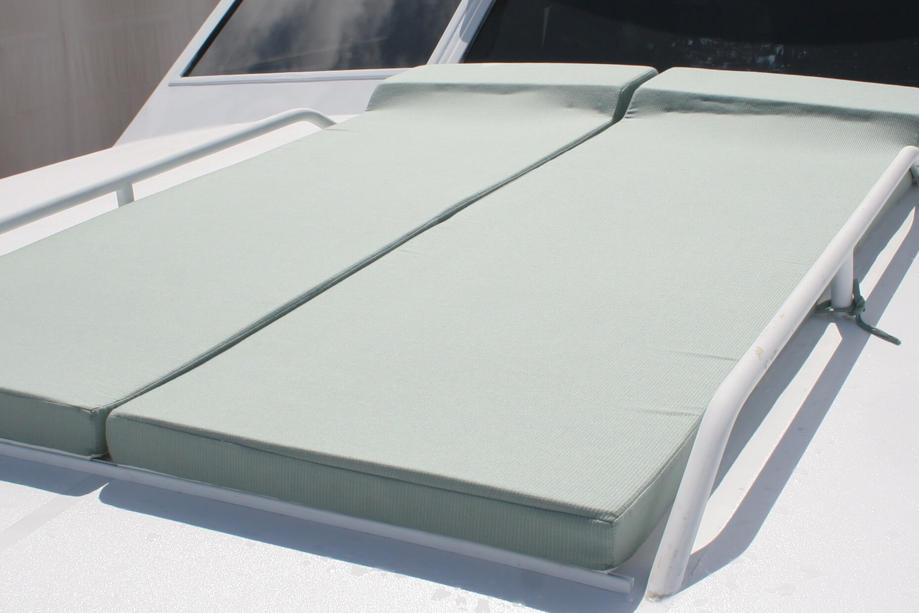 Sunpads covered in Sunbrella fabrics offer a place to enjoy the sun on a boat deck