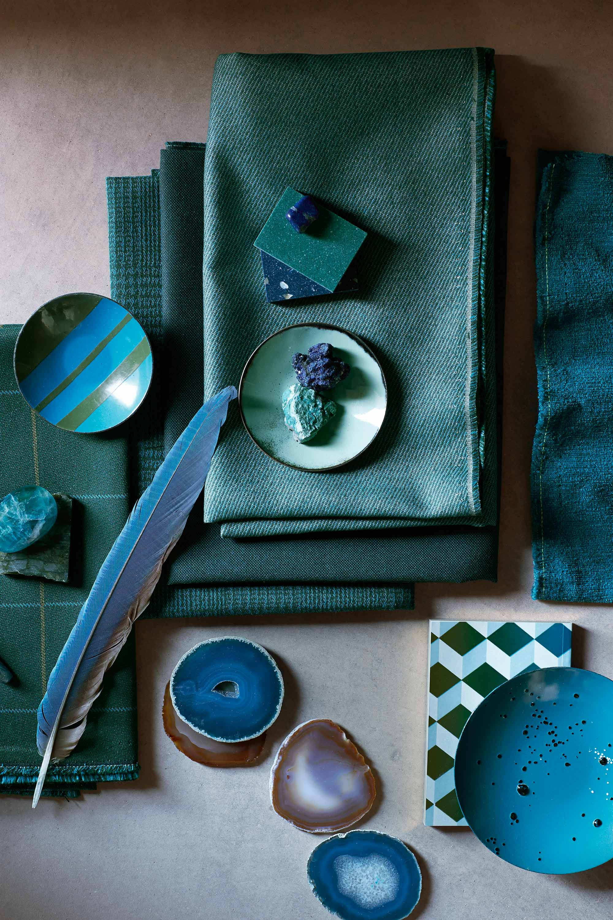 Teal Sunbrella upholstery fabrics folded with accessories